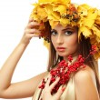 Beautiful young woman with yellow autumn wreath and red berries, isolated on white — Stock Photo #19693145