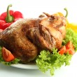Tasty whole roasted chicken on plate with vegetables, isolated on white — Stock Photo