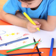 Child drawing in his album — Stock Photo