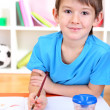 Cute little boy painting in his album — Stock Photo