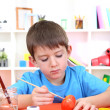 Cute little boy painting easter eggs — Stock Photo #19698555
