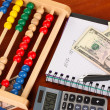 Bright wooden abacus and calculator. Conceptual photo of old and modern business — Stock Photo