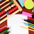 Toy abacus, note paper, pencils on bright background — Foto de Stock