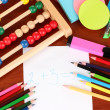 Toy abacus, note paper, pencils on bright background — 图库照片