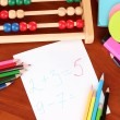 Toy abacus, note paper, pencils on bright background — Foto Stock