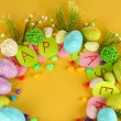 Circular composition for Easter on yellow background — Stock Photo