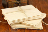Stacks of old letters on wooden table — Stock Photo