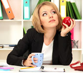 Beautiful young business woman smarten in office — Stock Photo