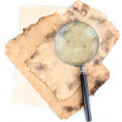 Old paper with magnifying glass isolated on white — Stok fotoğraf