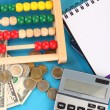 Bright wooden abacus and calculator. Conceptual photo of old and modern business — Stockfoto