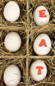 Decorative Easter eggs in wooden basket close up — Stockfoto