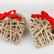 Wicker hearts with red bow isolated on white — Stock Photo