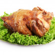 Tasty whole roasted chicken on plate with lettuce leaves, isolated on white — Stock Photo