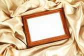 Empty frame on beautiful silk — Stock Photo