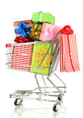 Christmas gifts and shopping in trolley isolated on white — Stockfoto