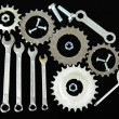 Machine gear, metal cogwheels, nuts and bolts isolated on black - Stockfoto