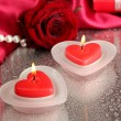 Beautiful candles, rose and red silk on grey wet background — Stock Photo #19776947