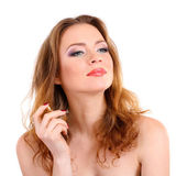 Young woman applying perfume isolated on white — Stock Photo