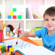 Cute little boy painting in his notebook — Stock Photo #19783555