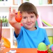 Royalty-Free Stock Photo: Cute little boy painting easter eggs