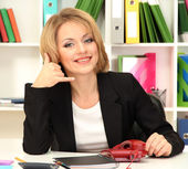 Beautiful young business woman working in office — Stock Photo