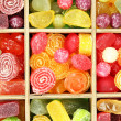 Multicolor candies in wooden box, close up — Стоковая фотография