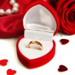 Beautiful box with wedding ring and rose on red silk background — Foto Stock