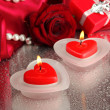 Beautiful candles, rose and red silk on grey wet background — Stock Photo #19845629