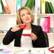 Beautiful young business woman at lunch break in office — Stock Photo #19895605