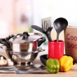 Composition of kitchen tools and vegetables on table in kitchen — Stock Photo #19894563
