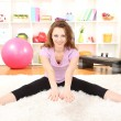 Young woman doing fitness exercises at home - Foto Stock