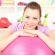 Royalty-Free Stock Photo: Young woman with gym ball at home