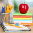 Stock Photo: School supplies with apple on wooden table
