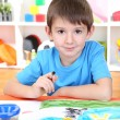 Cute little boy painting in his album — Stock Photo #19896135
