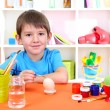 Cute little boy painting easter eggs — Stock Photo #19896161