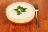 Mashed potatoes in wooden bowl on table close-up — Stock Photo