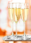 Corporate party: sparkling champagne glasses on tray — Stock Photo