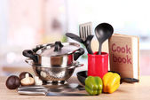 Composition of kitchen tools and vegetables on table in kitchen — Stock Photo