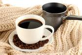 Cup of coffee with scarf close-up — Zdjęcie stockowe