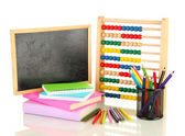 Toy abacus, school desk, books and pencils, isolated on white — Stock Photo