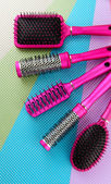 Comb brushes on bright background — Stock Photo