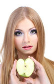 Beautiful young woman with glamour make up and apple, isolated on white — Stock Photo