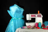 Sewing machine, dummy and other sewing equipment isolated on black — Stock Photo