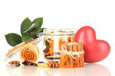 Decorative rose from dry orange peel in glass vase and burning candle isolated on white — Stock Photo