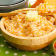 Stock Photo: Taste rice porridge with pumpkin, close up