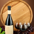Composition of wine, wooden barrel and grape, on brown background — Stock Photo #20001115