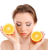 Beautiful young woman with bright make-up, holding orange, isolated on white — Stock Photo