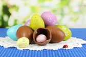 Composition of Easter and chocolate eggs on natural background — Stock Photo