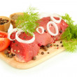 Raw beef meat marinated with herbs and spices isolated on white — Stock Photo