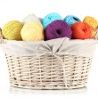 Stock Photo: Colorful yarn balls in wicker basket isolated on white